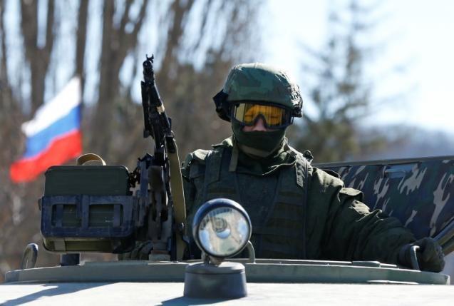 Putin khẳng định có người Nga 'làm nhiệm vụ quân sự' tại Ukraine  - ảnh 1