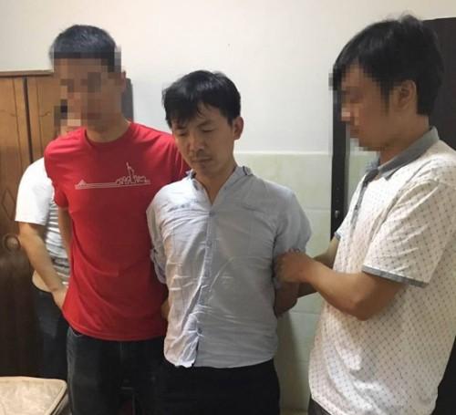 Trung Quốc bắt giữ nghi phạm lừa đảo tiền tỉ - ảnh 1