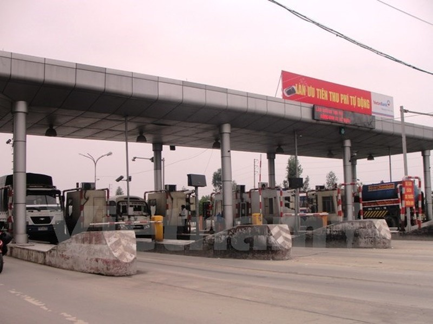 Trạm thu phí ùn tắc trên 1 km thì phải tạm dừng thu tiền, mở cổng - ảnh 1