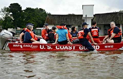 Louisiana ngập lụt và kỳ nghỉ hè của Obama - ảnh 1