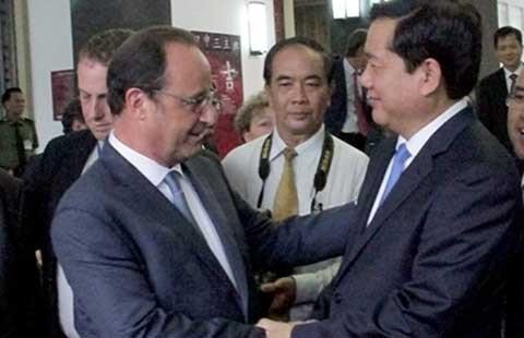 Tổng thống Pháp Hollande ấn tượng về sự phát triển của TP.HCM  - ảnh 1