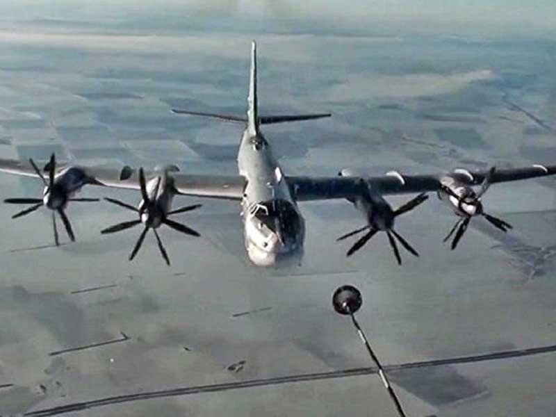 Máy bay từ Nga bay 11.000 km bắn tên lửa xuống Syria - ảnh 1