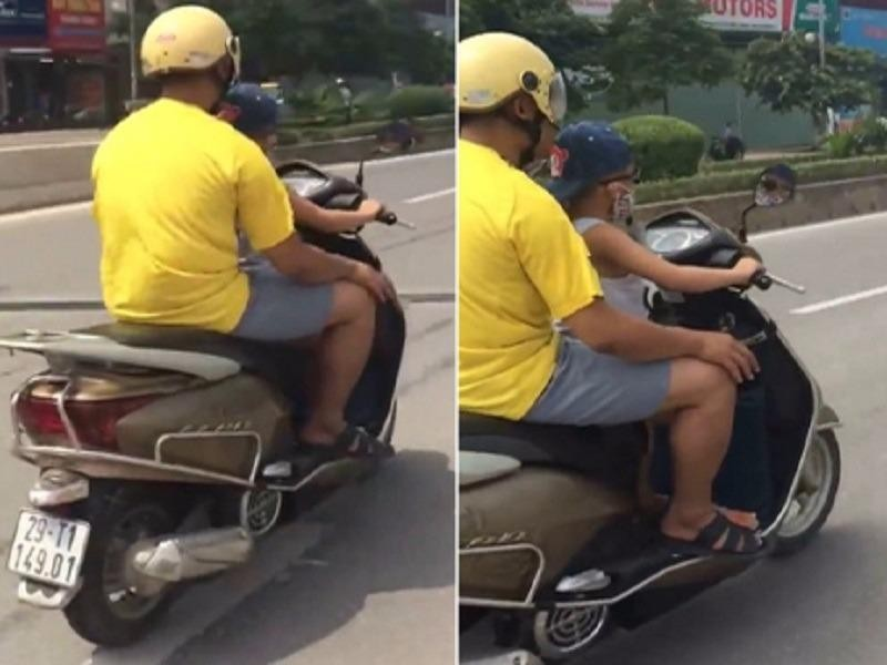 Hình ảnh ông Tuệ cho con trai 6 tuổi điều khiển xe máy.