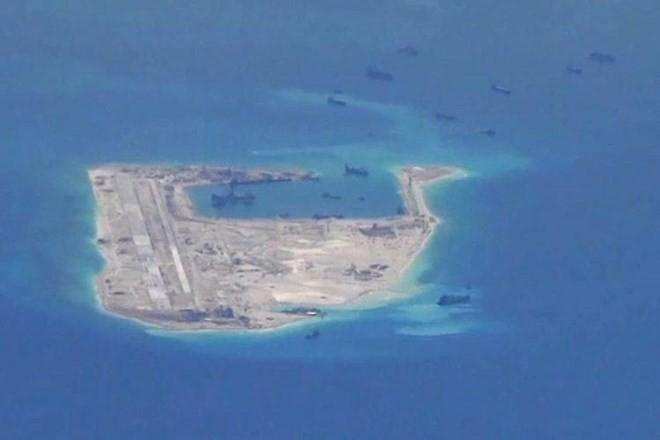 G-7 mạnh mẽ phản đối Trung Quốc xây đảo trái phép ở Biển Đông - ảnh 1
