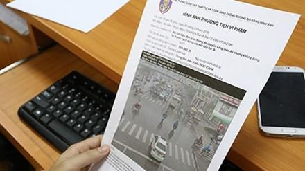 Hình ảnh của phương tiện vi phạm sẽ được in ra cùng với thông tin phân tích lỗi, là căn cứ để gửi tới người vi phạm để xử phạt. Ảnh: Bá Đô