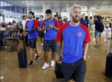 Messi với kiểu tóc mới