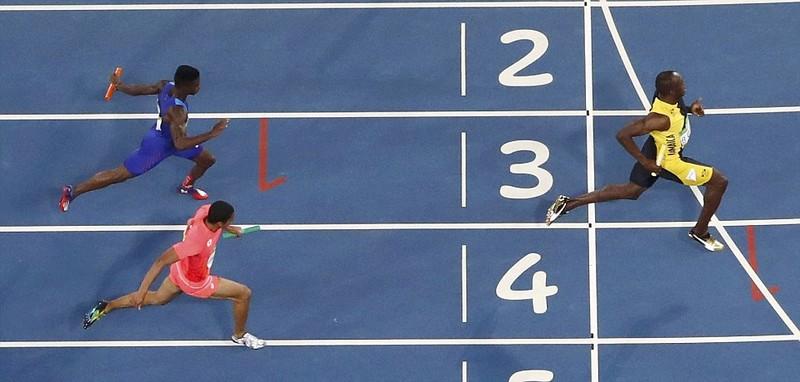 Giành HCV tiếp sức 4x100 m, Usain Bolt hoàn thành kỷ lục '3-3' - ảnh 1